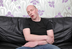 Sleeping sofa man Stock Images