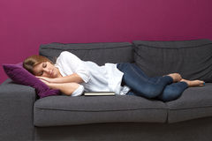 Sleeping on sofa stock photo