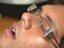 Sleeping with spectacles Stock Images