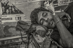 Sleeping in the street. Royalty Free Stock Photo