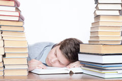 The sleeping student with books. Isolated on a light background Royalty Free Stock Images