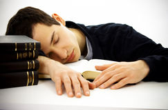 The sleeping student with books. Isolated on a white background Stock Image