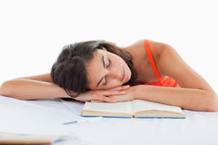 Sleeping student head on her books Stock Photos