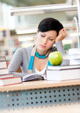 Sleeping student at the reading hall Royalty Free Stock Photography