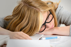 Sleeping student teenager lying on table Stock Photo