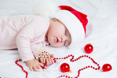 Sleeping sweet baby girl Santa Claus Royalty Free Stock Image