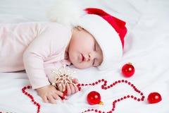 Sleeping sweet baby girl Santa Claus Royalty Free Stock Image
