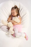 Sleeping with teddy Stock Photos