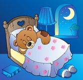 Sleeping teddy bear in bedroom Royalty Free Stock Images