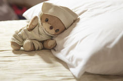 A sleeping teddy bear Stock Images