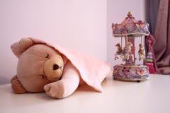 Sleeping teddy bear stock photo