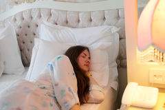 Sleeping teen. On a bed in the hotel Stock Image