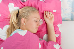 Sleeping teen girl. In bed Stock Photography