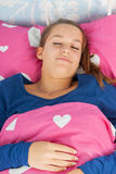 Sleeping teen girl. In bed Royalty Free Stock Photography