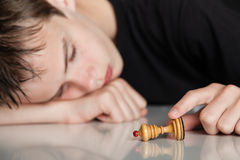 Sleeping Teenage Boy Holding Pawn Chess Piece Stock Photos