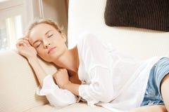 Sleeping teenage girl at home Stock Photos