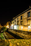 Sleeping time I. Urban scene of a river crossing the old part of the city of Granada, Spain, taken at night Stock Photography