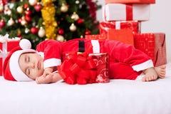 Sleeping tired baby santa claus Stock Image