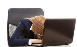 Sleeping, tired business woman at call center by the laptop. Royalty Free Stock Photos