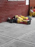 Sleeping tired helpers in in avenida Medellin during Mexico City earthquake Stock Image