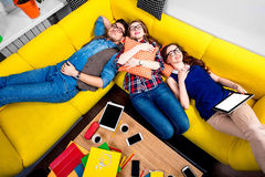 Sleeping and tired students on the couch Royalty Free Stock Photo