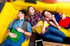 Sleeping and tired students on the couch Stock Photos
