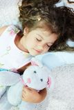 Sleeping with toy Stock Photo