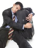 Sleeping traveling businessman Stock Image