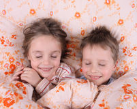 Sleeping twins Stock Images