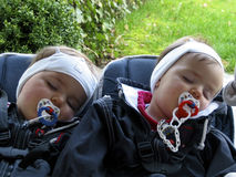 Sleeping twins in the baby carriage (B). Sleeping twins in the baby carriage, heads to the right side Royalty Free Stock Image