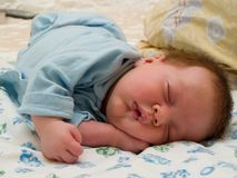 Sleeping two month baby. In the home nursery Stock Photo