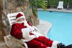 Sleeping Vacationing Santa Stock Photo