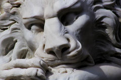 Sleeping White Lion Statue. Closeup of White Lion sculpture showing lions face Royalty Free Stock Image
