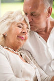 Sleeping wife and caring husband Royalty Free Stock Photo