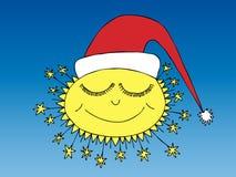 Sleeping winter sun in santa cap Royalty Free Stock Photos