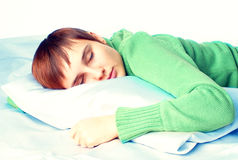 Sleeping woman. Young woman sleeping in bed Stock Images