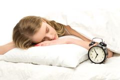 Sleeping woman with alarm clock Stock Images