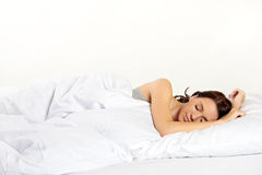 Sleeping woman in bed Stock Image