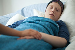 Sleeping woman with cancer stock photography