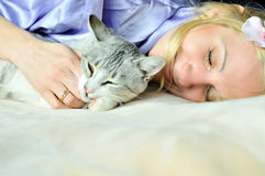 Sleeping woman and cat Stock Photo