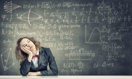 Sleeping woman in classroom Stock Image