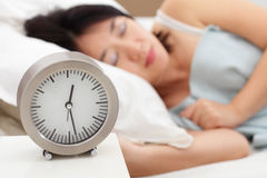 Sleeping Woman and Clock Stock Photos