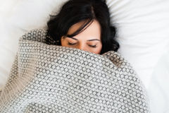 Sleeping woman cover face with blanket flat lay Royalty Free Stock Image