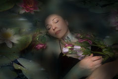 Sleeping woman in a dark water of a river stock image