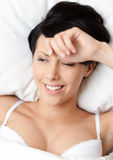 Sleeping woman in the double bed Stock Photos