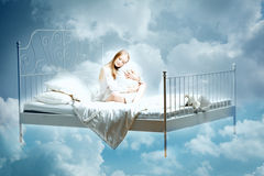 Sleeping woman. Girl with a pillow and blanket on the bed among Stock Image