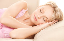 Sleeping woman at home Stock Images