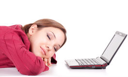 Sleeping woman with laptop Stock Photo
