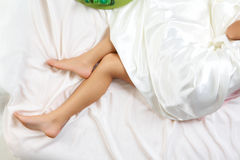 Sleeping woman legs Royalty Free Stock Photo