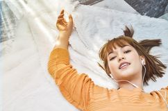 Sleeping woman listening to music happily. royalty free stock photo